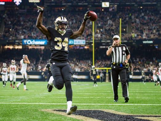 New Orleans Saints defensive back Justin Hardee scores