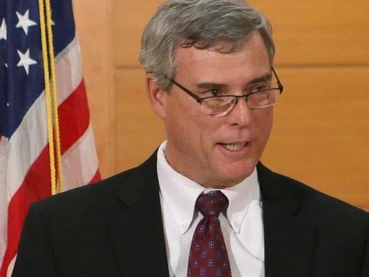Ferguson grand juror sues to remove gag order