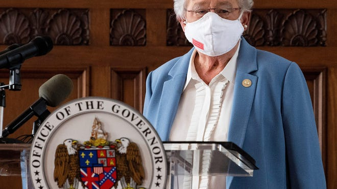 Gov. Kay Ivey arrives to ask Alabamians to continue wearing masks and use social distancing during a coronavirus update Tuesday in the state capitol building in Montgomery.