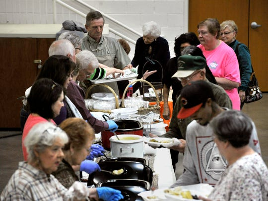 Congregation members serve up a turkey dinner during Thursday's Thanksgiving meal at First United Methodist Church in Breckenridge. The fundraiser dinner has been a tradition since the early 1950s.