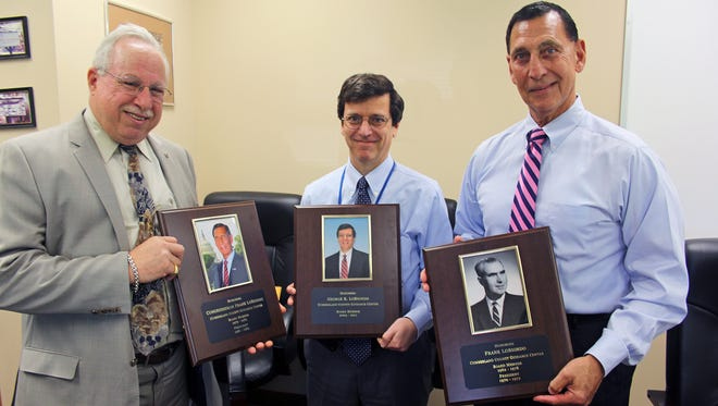 (From left) M. Jay Einstein, president of The Guidance Center, presents plaques to George LoBiondo and U.S. Rep. Frank LoBiondo to honor the family's three generations of community service as board members for the agency.