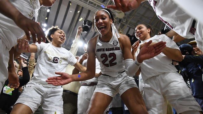 South Carolina forward A'ja Wilson (22) celebrates with her teammates after they defeated Mississippi State 59-49 in SEC women's basketball championship on Sunday, March 5, 2017 at Bon Secours Wellness Arena.