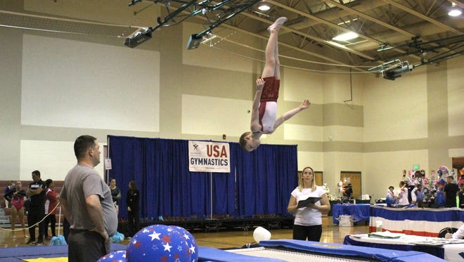 West Fowler competes in the trampoline gymnastics event in an undated photograph. Fowler, 8, will return to his birthplace of Milwaukee, Wisconsin to compete for national titles in three disciplines.