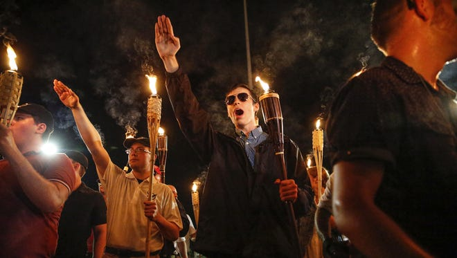 Multiple white nationalist groups march with torches through the University of Virginia campus in Charlottesville on Friday, August 11, 2017.