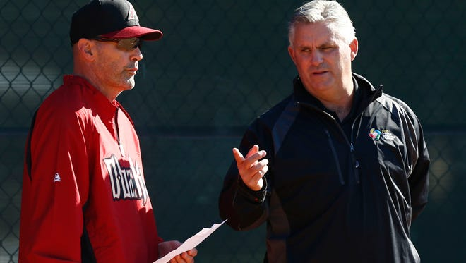 Diamondbacks manager Kirk Gibson and general manager Kevin Towers during spring training workouts at Salt River Fields at Talking Stick.