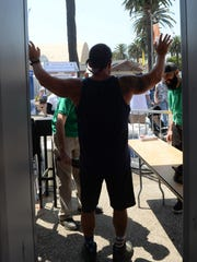 Ventura County Fair personnel use a metal detector at the fair's main entrance.