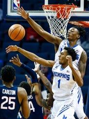 Memphis teammates Jamal Johnson (bottom right) and