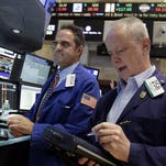 Specialist Jorge Fernandez, left, and trader James Riley work on the floor of the New York Stock Exchange, Friday, Aug. 28, 2015. U.S. stocks are opening slightly lower after a sharp two-day surge, as the stock market closes out a wild week.