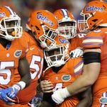 Florida wide receiver Brandon Powell (4), center, is congratulated by teammates after scoring a 77-yard receiving touchdown during the first half of an NCAA college football game against Mississippi Saturday, Oct. 3, 2015, in Gainesville, Fla. (AP Photo/Gary McCullough)
