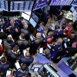 Traders gather at the post that handles Allergan on the floor of the New York Stock Exchange,Thursday, Oct. 29, 2015. Allergan, which makes Botox, jumped 8 percent after saying it has held talks with Pfizer about a sale. (AP Photo/Richard Drew)