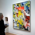 Willem de Kooning's Untitled XXI, a richly colored painting, estimated at $25 million to $35 million, is displayed at Sotheby's in New York, on Oct. 30, 2015. Sotheby's opens the fall art auction season on Wednesday with outstanding works from the renowned collection of its late former owner, A. Alfred Taubman.