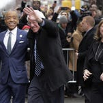 The Rev. Al Sharpton escorts Bernie Sanders as they arrive for a breakfast meeting in New York Wednesday. The Rev. Al Sharpton, left, escorts Democratic presidential candidate Sen. Bernie Sanders, I-Vt. and his wife, Jane O'Meara Sanders, as they arrive for a breakfast meeting at Sylvia's Restaurant, Wednesday, Feb. 10, 2016, in the Harlem neighborhood of New York. Sanders defeated former Secretary of State Hillary Clinton on Tuesday in the New Hampshire primary. (AP Photo/Richard Drew)