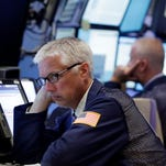Traders work in a booth on the floor of the New York Stock Exchange, Tuesday, July 5, 2016.  (AP Photo/Richard Drew)