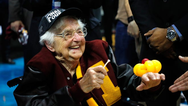 Loyola-Chicago's 98-year-old team chaplain, Sister Jean Dolores-Schmidt, celebrates the team's win over Kansas State, 78-62, in the Elite Eight on March 24 in Atlanta. She has become a national sensation during the Ramblers' tournament run.