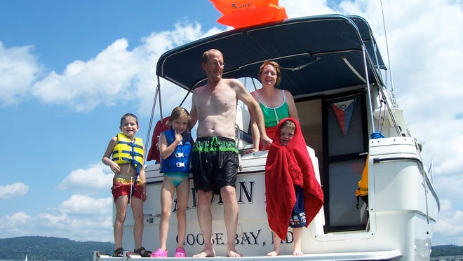 Scott Croft's brother Rich, wife April Croft, with their kids on their yacht at Croton Point.