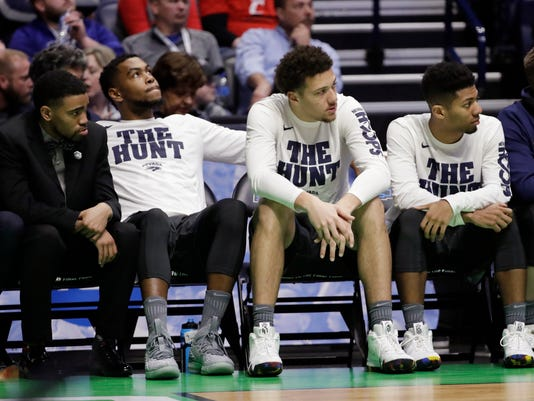 The Nevada bench looks up during the first half of a second-round game against Cincinnati, in the NCAA college basketball tournament in Nashville, Tenn., Sunday, March 18, 2018. (AP Photo/Mark Humphrey)