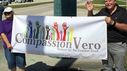 "Compassion Vero is a community-wide initiative aimed to bring together religious, political, school district and business leaders of all perspectives to have open dialogues about increasing human compassion. On Election Day, 18 people from the group waved signs with sayings like ""Vote with gratitude,"" ""Kindness is contagious"" and ""Love your neighbor."""