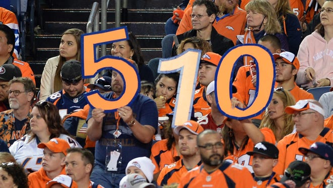 Denver Broncos fans hold a sign for the total amount of touchdowns quarterback Peyton Manning (18) (not pictured) now has during the third quarter against the San Francisco 49ers at Sports Authority Field.