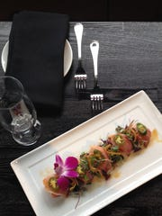 At The Gallery Restaurant in Westlake Village, a yellowtail and watermelon sashimi appetizer is featured on the dineL.A. menu in effect through Jan. 26.