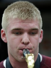 Aaron Peters concentrates on playing the saxohpone in Marshfield High School band room March 17, 2016.