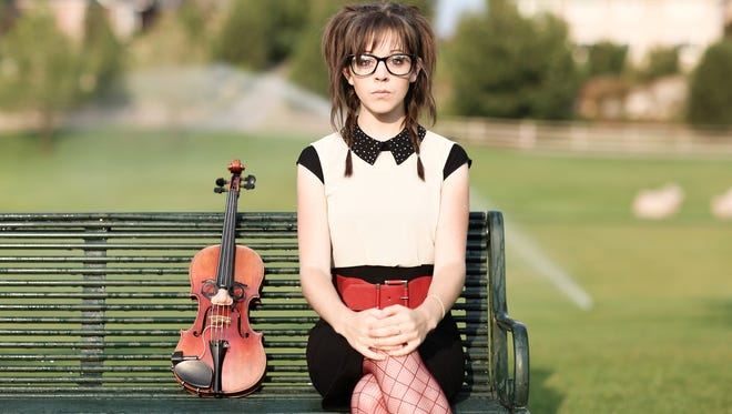 YouTube sensation Lindsey Stirling, 27, plays violin in a new video for John Legend's 'All of Me.'