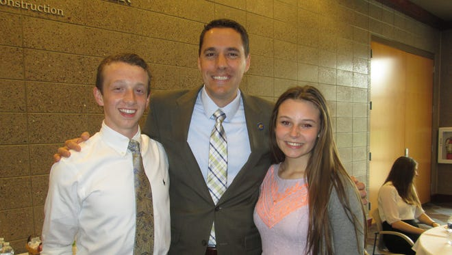 Badger State delegates Sam Solowicz (left) and Joey O'Neill (rright) met Senator Roger Roth (SMC Class of 1996) at St. Mary Catholic High School's Leadership Day.