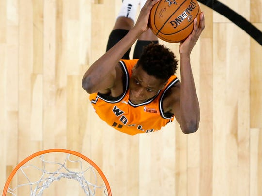 World Team's Frank Ntilikina, below, of the New York Knicks, dunks as U.S. Team's Donovan Mitchell, of the Utah Jazz, defends during the NBA All-Star Rising Stars basketball game, Friday, Feb. 16, 2018, in Los Angeles.