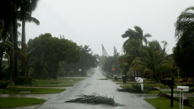 Downed power lines, felled trees, branches, and other debris litter Naples, Fla. and Bonita Springs, Fla. as Southwest Florida prepares for Hurricane Irma to make landfall midday Sunday, September 10, 2017.