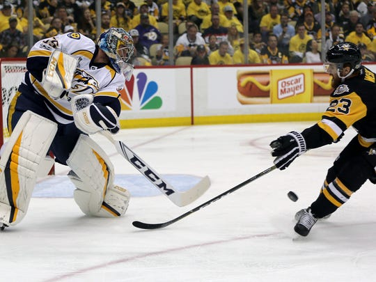 Nashville Predators goalie Pekka Rinne, left, clears the puck past Pittsburgh Penguins' Scott Wilson (23) during the second period in Game 1 of the NHL hockey Stanley Cup Finals on Monday, May 29, 2017, in Pittsburgh. (AP Photo/Keith Srakocic)
