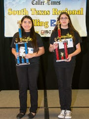 First-place winner Jessica Rivera of Cunningham Middle School (left) and second-place winner Athena Lankford of Gregory-Portland Junior High hold their trophies from the spelling bee.