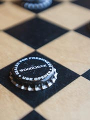 Visitors can play checkers with bottle tops at the