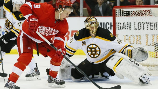 Apr 22, 2014; Detroit, MI, USA; Detroit Red Wings left wing Justin Abdelkader (8) shoots the puck against Boston Bruins goalie Tuukka Rask (40) in the third period in game three of the first round of the 2014 Stanley Cup Playoffs at Joe Louis Arena. Mandatory Credit: Rick Osentoski-USA TODAY Sports