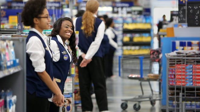 January 27, 2016 — Walmart cashier is Sandra Brown warmly greets customers at the Horn Lake Supercenter. The store officially opening early Wednesday morning following a brief ceremony featuring comments from Walmart and city officials. (Stan Carroll/The Commercial Appeal)