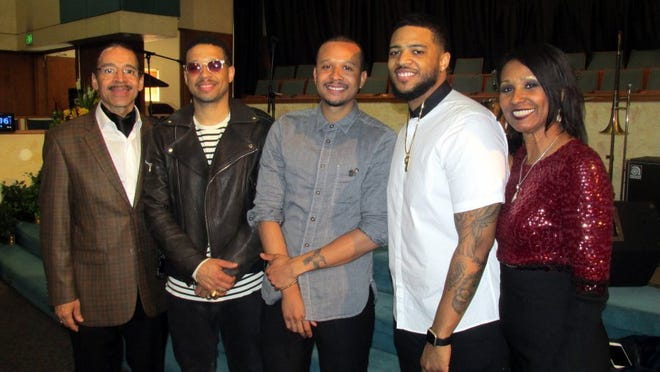 Sheila Whalum with (from left) her husband, Kenneth Whalum JR., and their sons, Kenneth III, Kortland and Kameron.