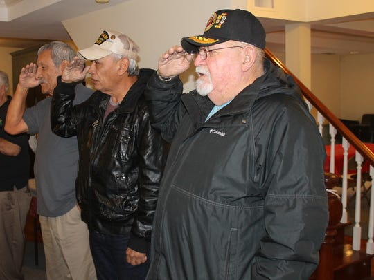 Raul Hernandez, left, Albert Elizondo and Armando Perez salute while pledge allegiance to the American flag Tuesday, Dec. 20, 2016.