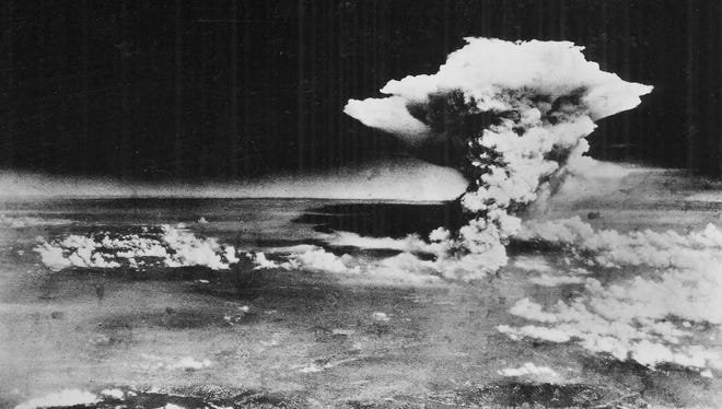 The mushroom cloud about one hour after the first atomic bomb was dropped on  Hiroshima, Japan, on Aug. 6, 1945.