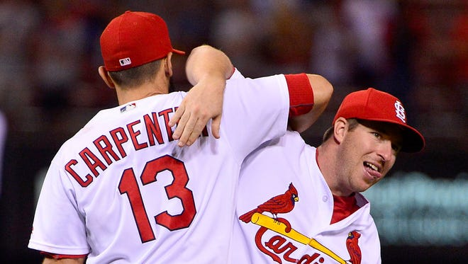 Jedd Gyorko (right), Matt Carpenter and the Cardinals are making their move in the NL Central.