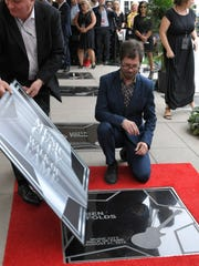 Ben Folds checks out his star on the Music City Walk
