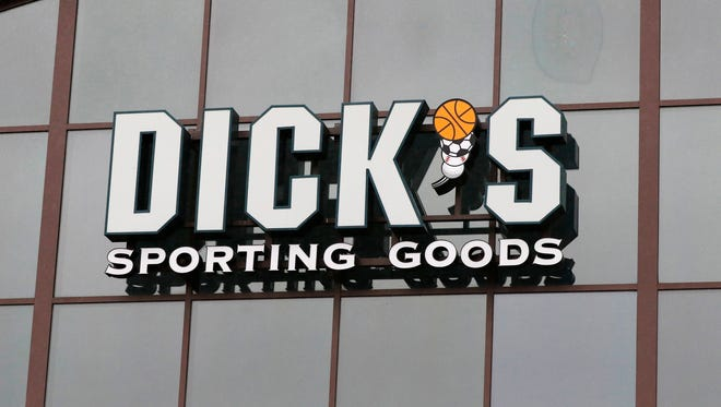 A sign for Dick's Sporting Goods store is displayed at the store Thursday, March 1, 2018, in Madison, Miss.