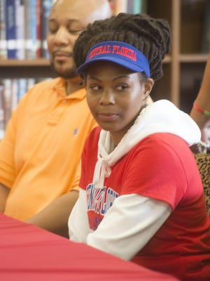 West Florida High School basketball standout Deja Jones signed a basketball scholarship with the College of Central Florida during a ceremony at the high school Friday morning.
