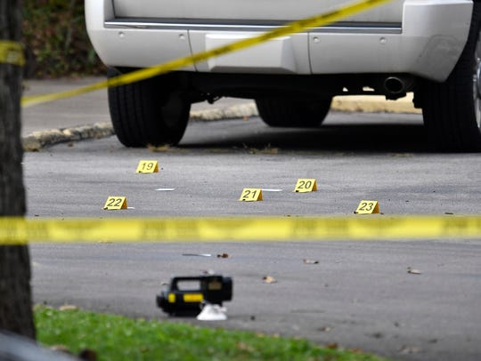 Evidence markers are on the ground in the parking lot