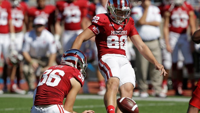 Indiana place kicker Griffin Oakes kicks a 48-yard field goal out of the hold of Erich Toth during the first half of an NCAA college football game against Maryland, Saturday, Sept. 27, 2014, in Bloomington, Ind. (AP Photo/Darron Cummings)