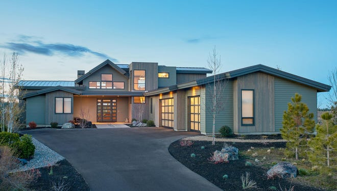 The contemporary exterior displays a variety of windows, including ones that draw light into the stairwell.