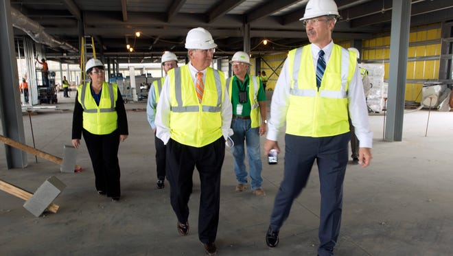 Bill Hafner, president of VT MAE, right, gets a tour of the company's new facility under construction at Pensacola International Airport Friday, Oct. 27, 2017.