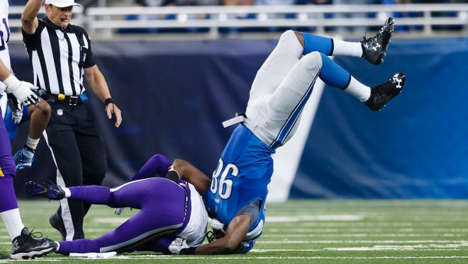 Minnesota Vikings quarterback Teddy Bridgewater is sacked by Detroit Lions defensive end Devin Taylor, right, on Oct. 25, 2015, in Detroit.