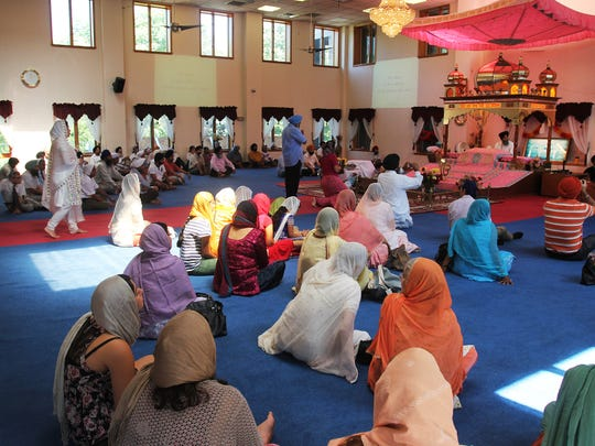 Worshippers held a vigil at the Sri Singh Sabha Sikh Temple in Glen Rock in August 2012 after six people were killed at a Sikh temple outside Milwaukee.