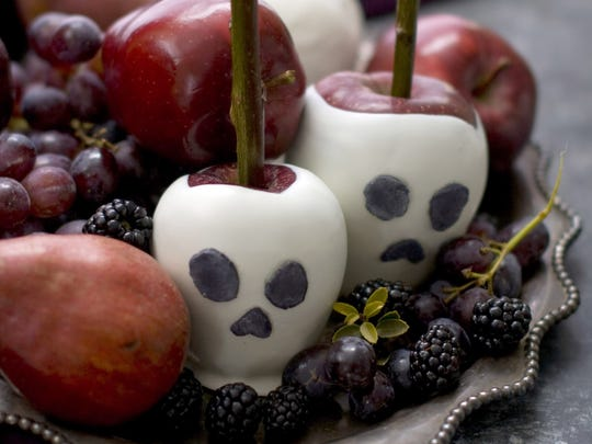 Whip up some candied apple craniums made from red apples dipped in white candy melts.