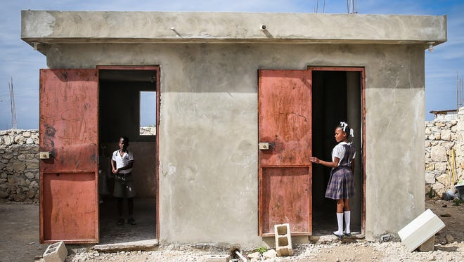 Children use latrines with flushing toilets on the school grounds on March 6, 2018, at the David Steward Christian Institution for Boys and Girls in Onaville, Haiti. The latrine with running water is a rarity in the community.