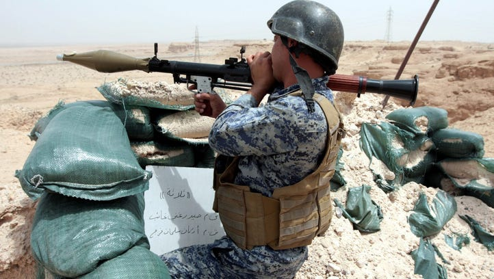 An Iraqi soldier holds a rocket propelled grenade during