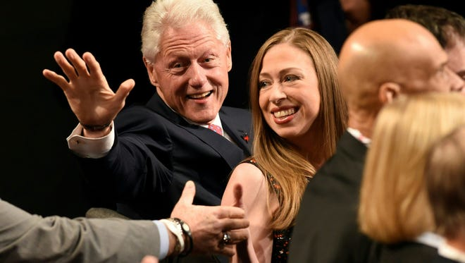 Former President Bill Clinton and his daughter, Chelsea Clinton, attend the presidential debate Oct.19 in Las Vegas. Bill Clinton will hold a rally in Fort Collins on Friday, days after Chelsea Clinton campaigned in Boulder for Hillary Clinton's presidential bid.